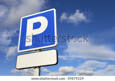 parking signal with cloudy sky