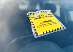 Parking ticket fine issued for parking violation while parking car in restricted no-parking zone