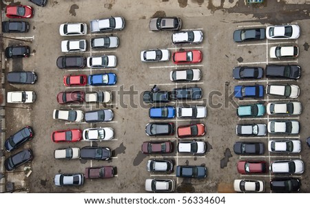 Parking with parked cars. Aerial view from a height.