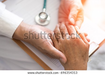 Parkinson and alzheimer female senior elderly patient with physician doctor in hospice care.