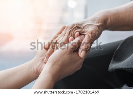 Parkinson disease patient, Alzheimer elderly senior, Arthritis person's hand in support of nursing family caregiver care for disability awareness day, National care givers month, ageing society