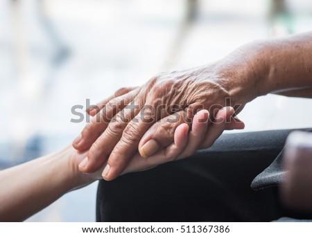 Parkinson disease patient or elderly senior person in support of nursing family caregiver concept