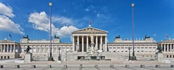 Parlament building at Vienna, Austria. Panorama of famous touristic attraction.