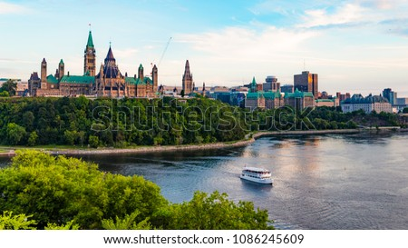 Parliament Hill and a Tour Boat on the Ottawa River in Summer