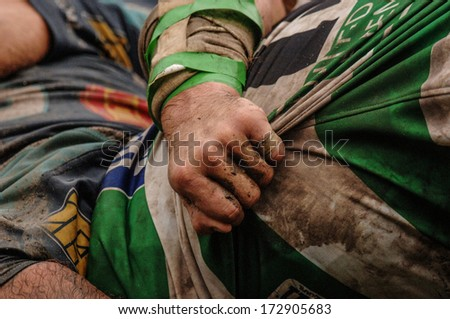 Parma, Italy - October 12: Close Up Of Rugby Players Arm Pushing In A Scrum During The Italian Rugby League Match Parma Vs Treviso, In Parma, October 12, 2005.
