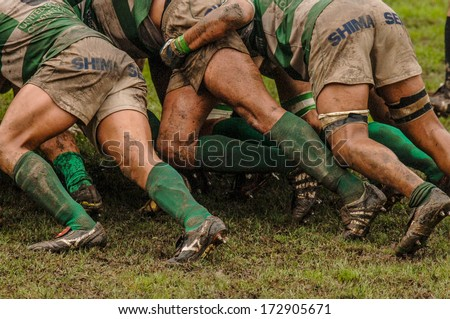 PARMA, ITALY - OCTOBER 12: Close up of rugby players muddy legs pushing in a scrum during the Italian Rugby League match Parma vs Treviso, in Parma, October 12, 2005.