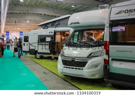 Parma, Italy - September 17, 2016: People looking at auto in annual exhibition of camper vans (Salone del Camper) #1104100319