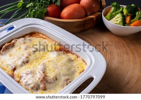 Parmegiana Steak also known as Filet Parmegiana. Accompanied by vegetable salad