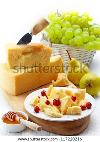 Parmesan cheese and fruits - stock photo