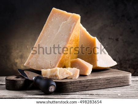 Parmesan cheese on a wooden board