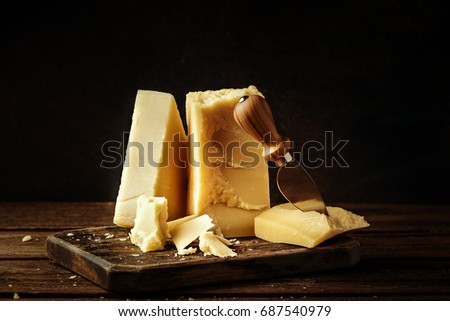 Parmesan cheese on wooden board.  Vintage view.