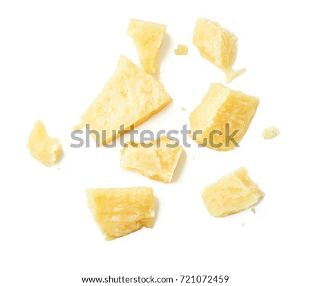 Parmesan cheese pieces on white background. Top view.