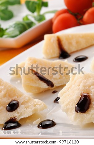 Parmesan cheese with balsamic vinegar of Modena