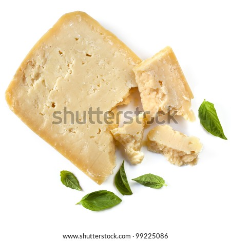 Parmesan cheese with fresh basil leaves, isolated on white background.  Overhead view.