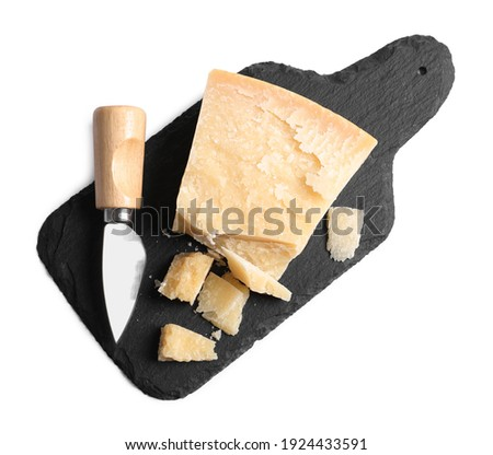 Parmesan cheese with knife and slate plate on white background, top view Foto d'archivio ©