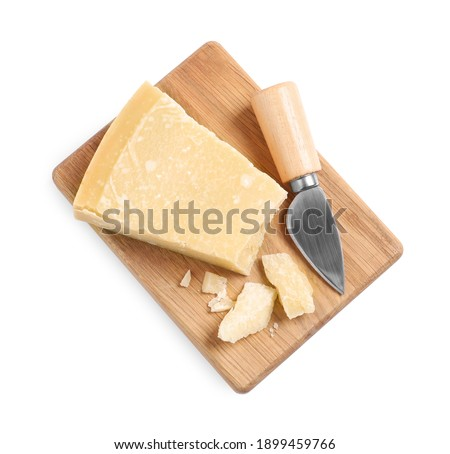 Parmesan cheese with knife and wooden board on white background, top view Foto d'archivio ©