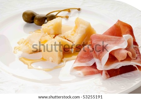 parmesan cheese with  parma  ham and capers