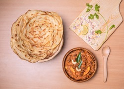 Parotta and Kadala Curry - This is parotta a layered flatbread made out of all purpose flour. It is one of the popular south Indian food from Kerala. This is served here with veg curry made of