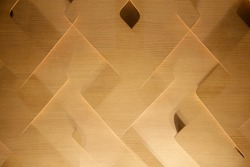 Parquet. Polygonal wooden panels. Abstract material background photo for construction industry, modern technology and architecture. Design with plywood boomerang. Polygonal geometrical pattern.