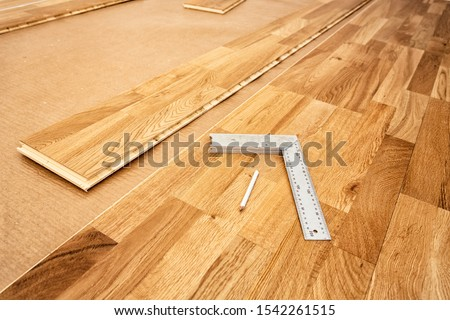 Parquetry, engineered click system oak wood flooring in a room t ストックフォト ©