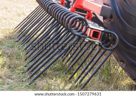 Part and detail of agricultural machine. Modern technology in agriculture concept