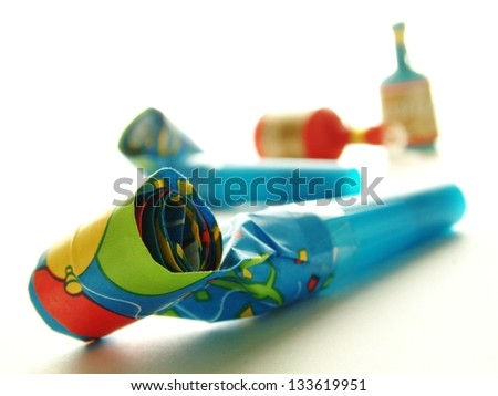 part blowers and party poppers on white background