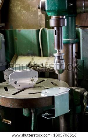 Part machining with drilling machine  #1305706516