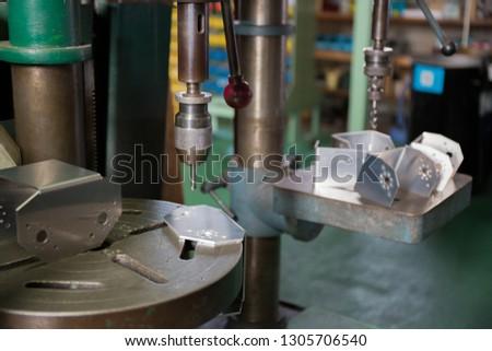 Part machining with drilling machine  #1305706540