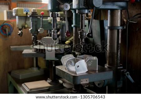 Part machining with drilling machine  #1305706543