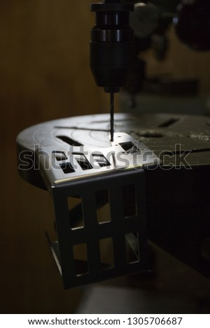 Part machining with drilling machine  #1305706687