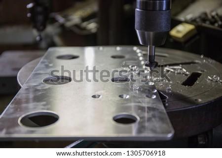 Part machining with drilling machine  #1305706918