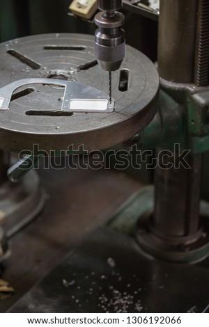 Part machining with drilling machine #1306192066