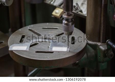 Part machining with drilling machine #1306192078