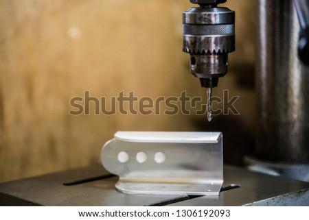Part machining with drilling machine #1306192093