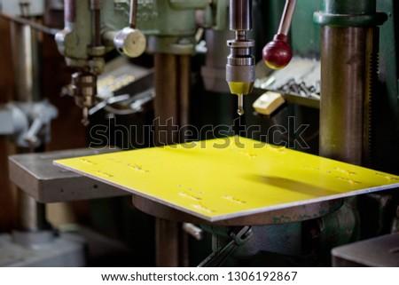 Part machining with drilling machine #1306192867