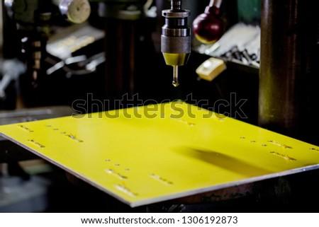 Part machining with drilling machine #1306192873