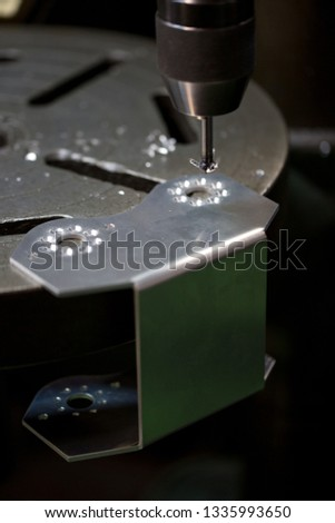 Part machining with drilling machine #1335993650