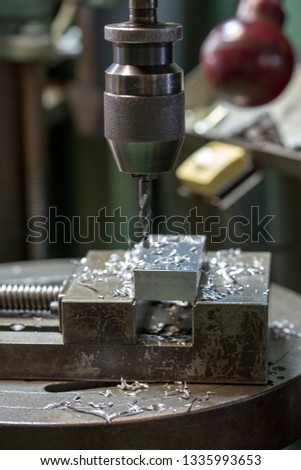 Part machining with drilling machine #1335993653