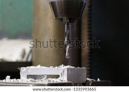 Part machining with drilling machine #1335993665