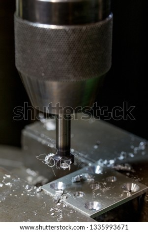 Part machining with drilling machine #1335993671