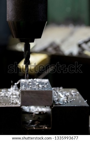 Part machining with drilling machine #1335993677