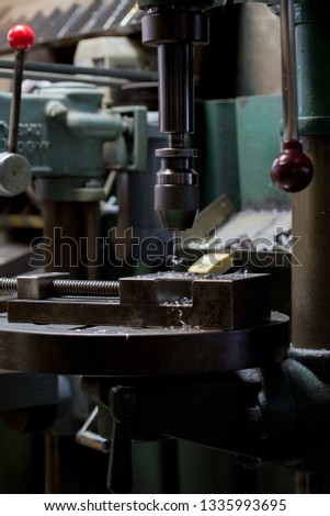 Part machining with drilling machine #1335993695