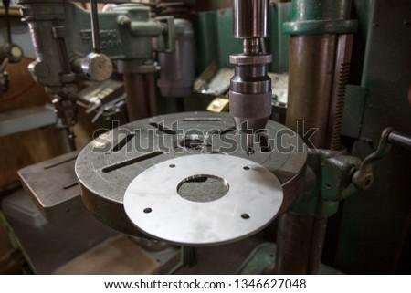 Part machining with drilling machine #1346627048