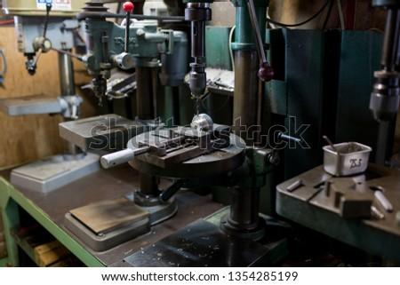 Part machining with drilling machine #1354285199