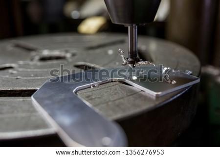Part machining with drilling machine #1356276953