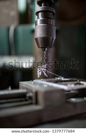 Part machining with drilling machine #1379777684