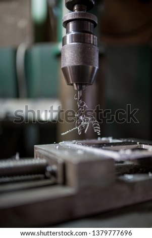 Part machining with drilling machine #1379777696