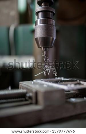 Part machining with drilling machine #1379777696