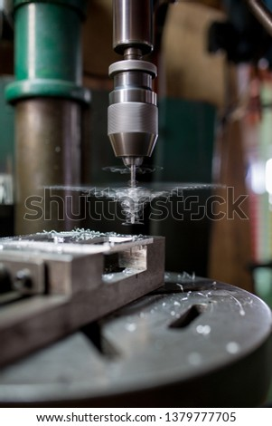 Part machining with drilling machine #1379777705