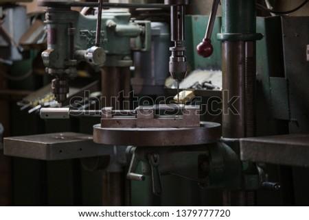 Part machining with drilling machine #1379777720